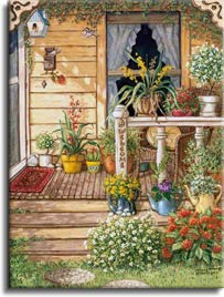 Summer Front Porch, an original oil painting and a giclee , personally enhanced and by the artist Janet Kruskamp showing the front door, narrow window and a deck like porch. Round aggregate paving stones lead up to the three steps of the porch, bordered on the right side with brightly colored white and red flowers. A wicker chair sits behing the white railing of the porch surrounded by pots of bright blooming flowers. Three colorful watering cans serve as planters on the second step up. A carved hanging chain of letters spells out WELCOME on the front rail post.